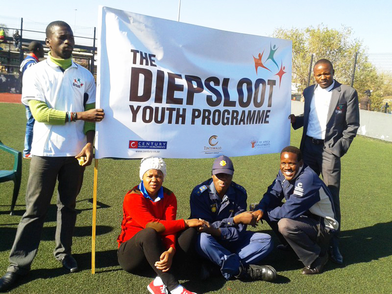 Diepsloot youth programme volunteers with banner.
