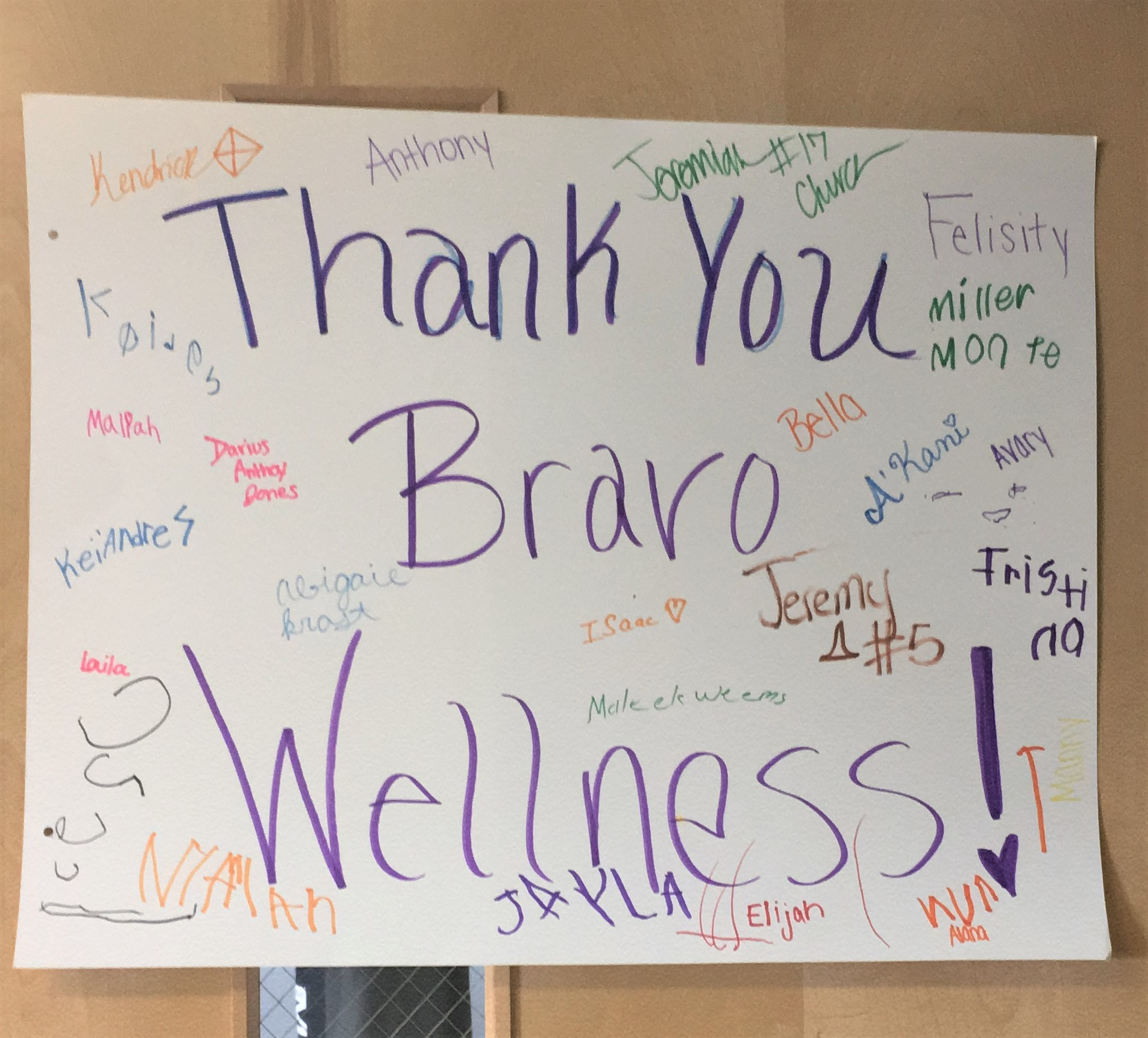 The kids who benefited from the matching donation, wrote a Thank You note to Bravo Wellness. Each of them signed it and hung it on the door.