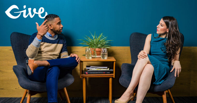 Man talking to a woman about donor relations.