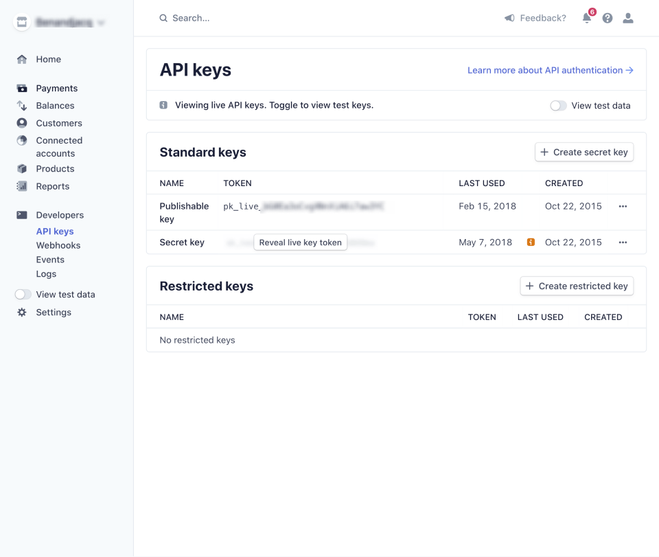 screenshot of the Stripe API keys interface with certain information blurred out for security.