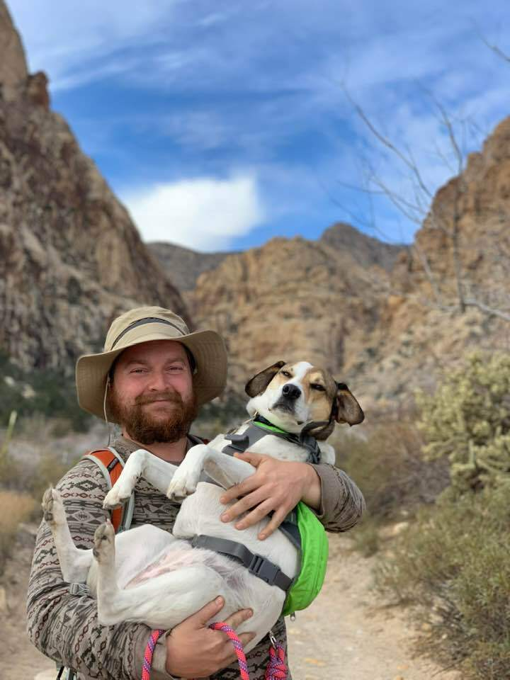Drew and his dog out in a canyon somewhere, wandering.