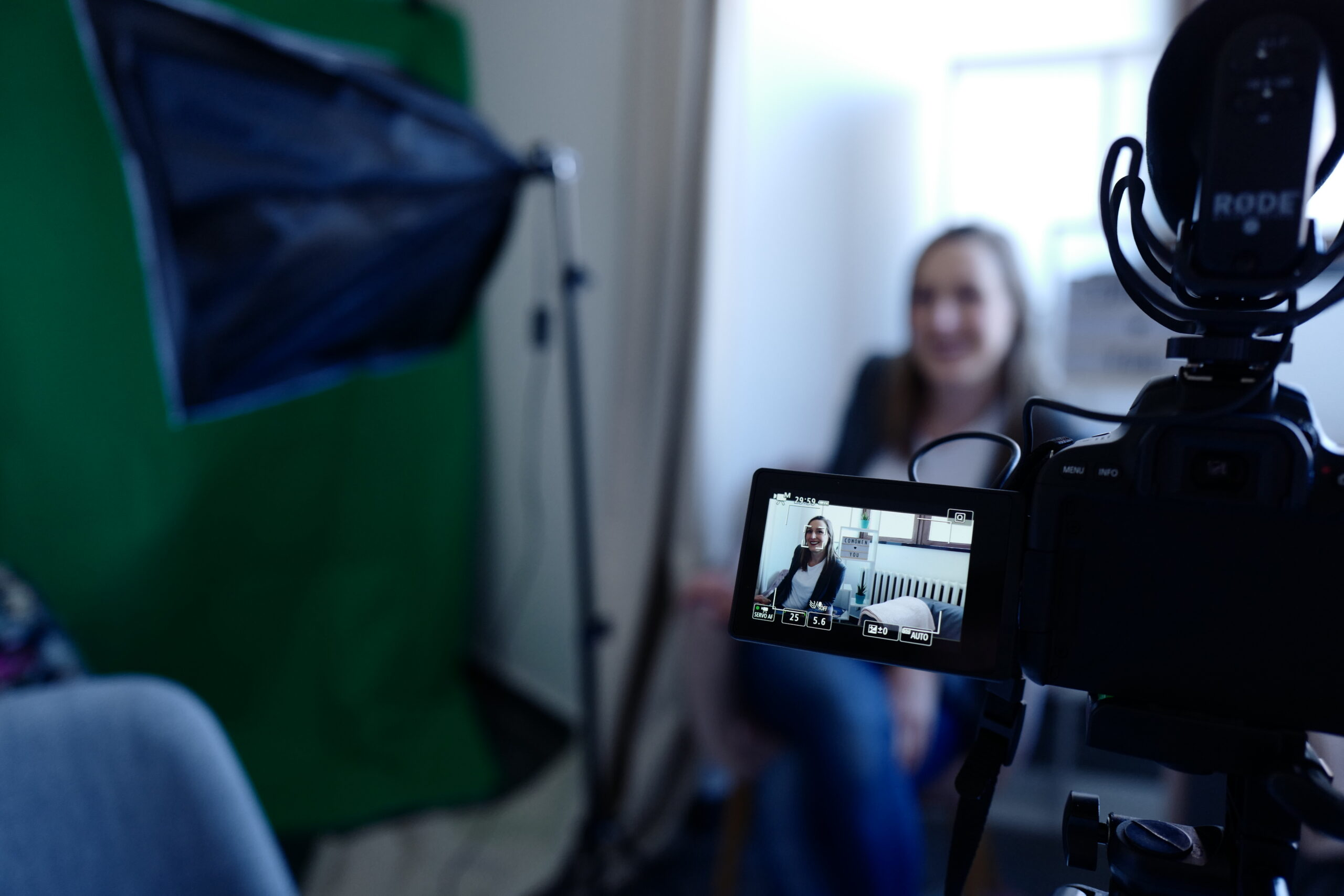 Woman interviewing in front of camera